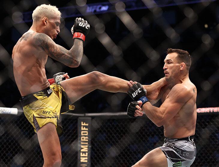Чарльз Оливейра выиграл бой за титул чемпиона в легком весе в рамках UFC
